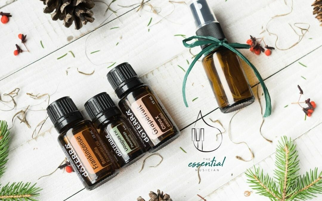 Essential Oils on a white wood background with fir and pinecones I DIY Gifts for the Perfectionist