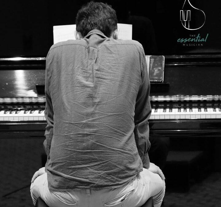 Pianist hunched over a piano | Managing discomfort without side effects